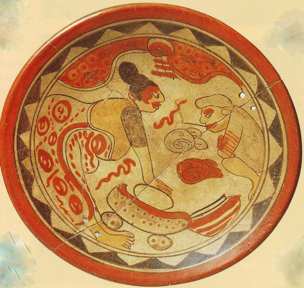 Abuela creadora Ixmukane moliendo la masa de maíz para la creación de los cuerpos de las primeras cuatro parejas. Frente a la Abuela Ixmukane está el Abuelo creador Ixpiyakok participando en la creación de nuestros primero ancestros de maíz.