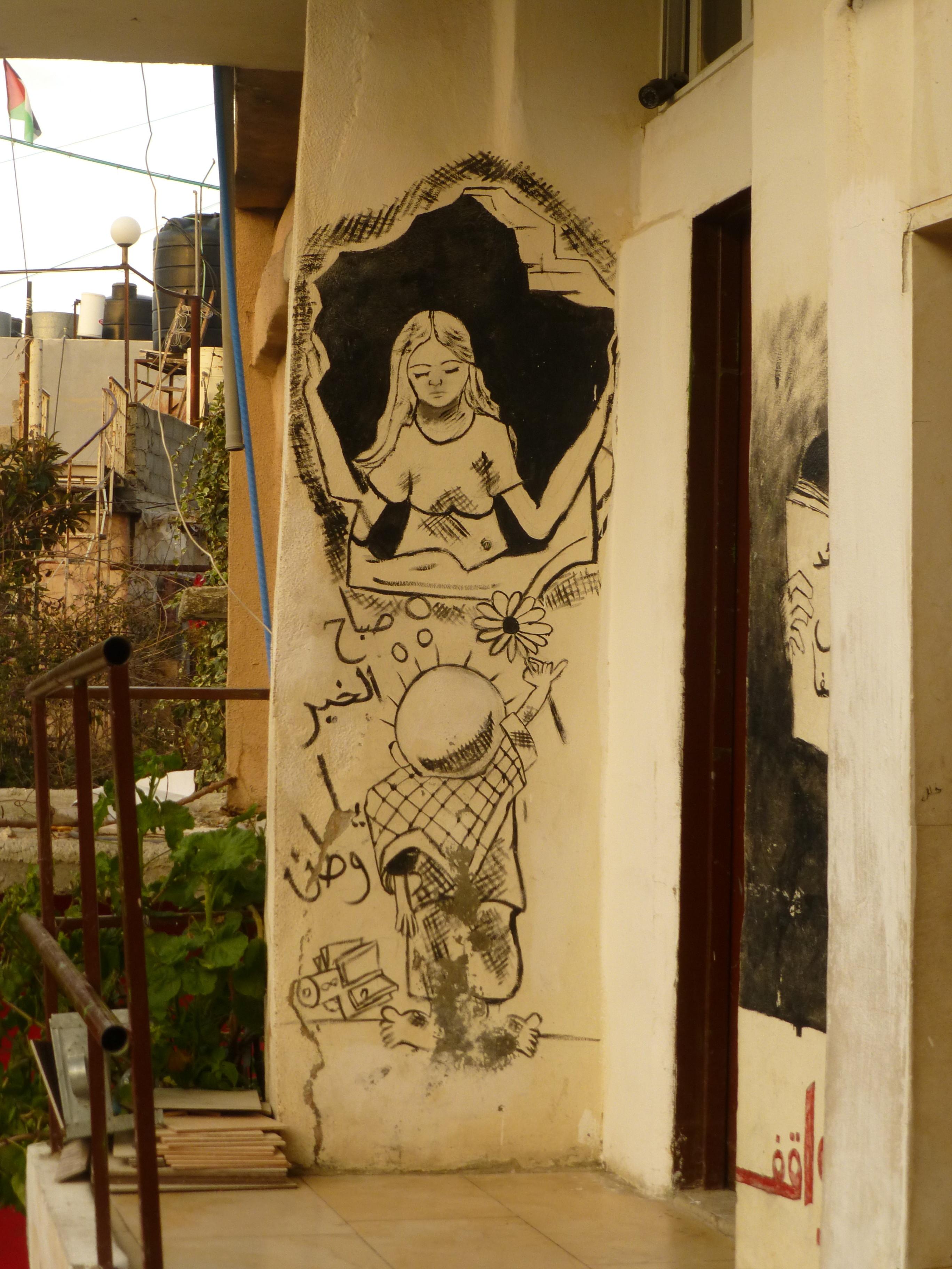 Uno de los diseños del niño Hadala de Naji Al-Ali, reproducido en la pared en Deheisheh