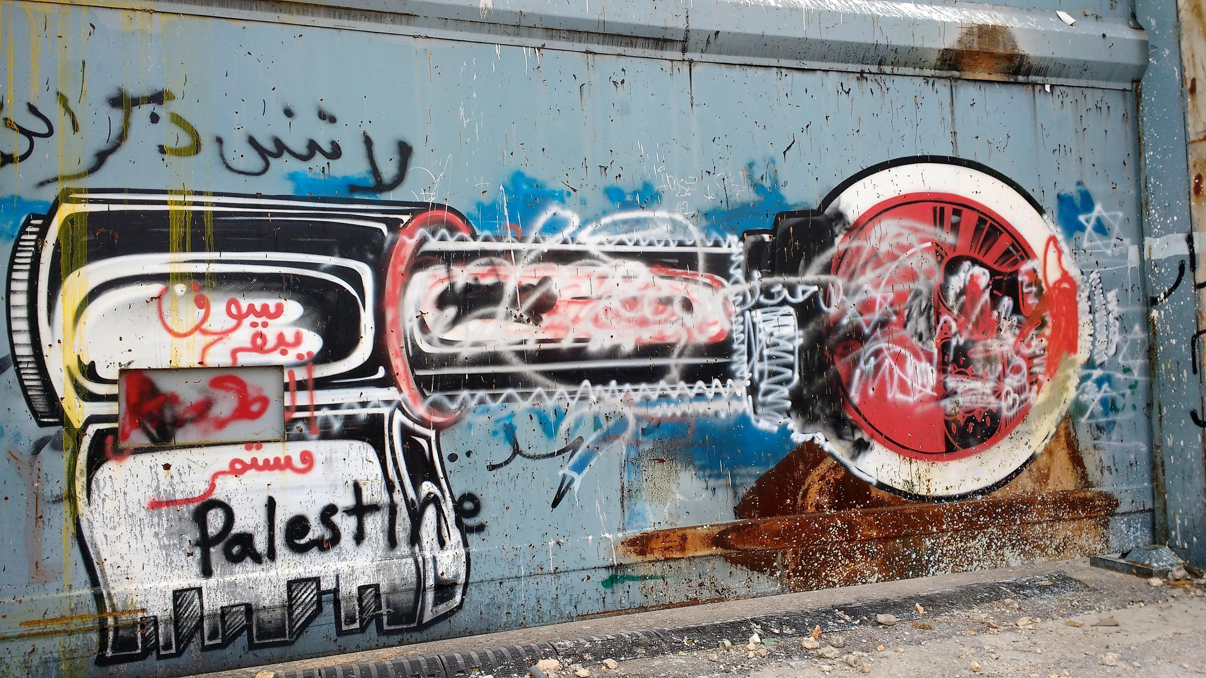 La llave, símbolo del sufrimiento palestino, pintado en un portón del muro de apartheid, construido a partir de 2002, en las afueras de Belén. Foto: Susana Norman
